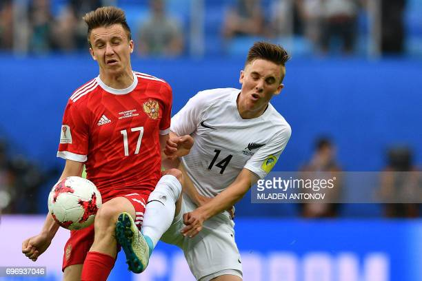 TOPSHOT Russia's midfielder Alexander Golovin vies for the ball against New Zealand's midfielder Ryan Thomas during the 2017 Confederations Cup group...