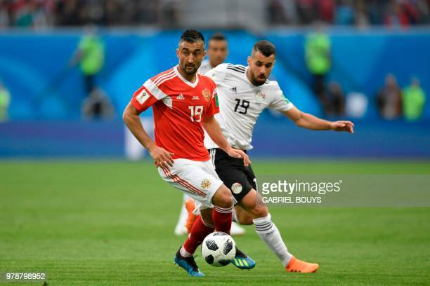 Russia's midfielder Alexander Samedov and Egypt's midfielder Abdallah Said vie during the Russia 2018 World Cup Group A football match between Russia...