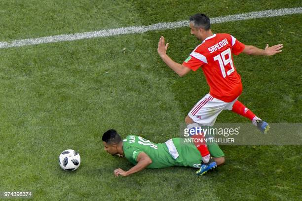 Russia's midfielder Alexander Samedov and Saudi Arabia's forward Salem AlDawsari compete for the ball during the Russia 2018 World Cup Group A...
