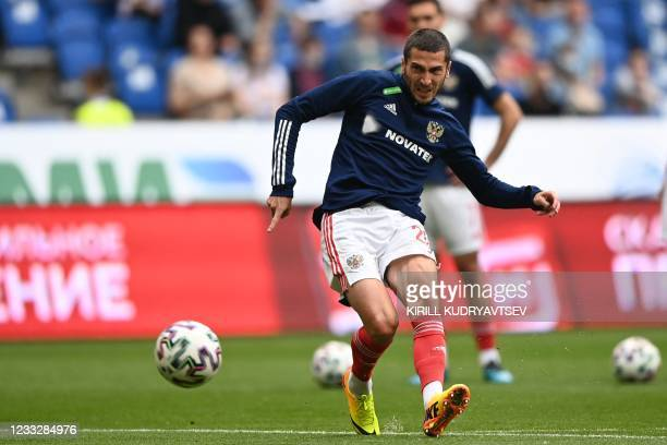 Russia's midfielder Alexei Ionov warms up prior to the friendly football match Russia v Bulgaria in Moscow on June 5 in preparation for the UEFA...