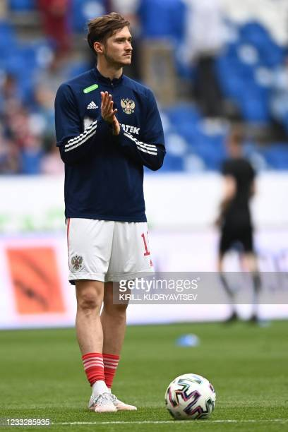 Russia's midfielder Alexei Miranchuk warms up prior to the friendly football match Russia v Bulgaria in Moscow on June 5 in preparation for the UEFA...