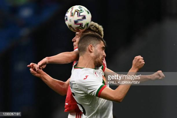 Russia's midfielder Andrey Mostovoy and Bulgaria's Petko Hristov vie for the ball during the friendly football match Russia v Bulgaria in Moscow on...