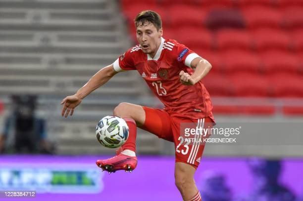 Russia's midfielder Daler Kuzyaev plays the ball during the UEFA Nations League football match between Hungary and Russia on September 6, 2020 at the...