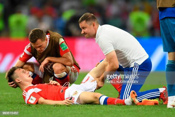 Russia's midfielder Denis Cheryshev and Russia's midfielder Aleksandr Golovin before the extra time of the Russia 2018 World Cup quarterfinal...