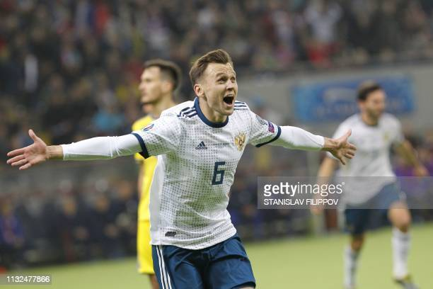 Russia's midfielder Denis Cheryshev celebrates after scoring a goal during the Euro 2020 football qualification match between Kazakhstan and Russia...