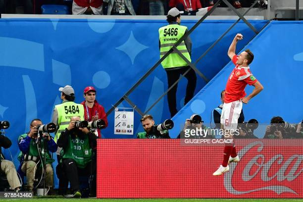Russia's midfielder Denis Cheryshev celebrates after scoring during the Russia 2018 World Cup Group A football match between Russia and Egypt at the...