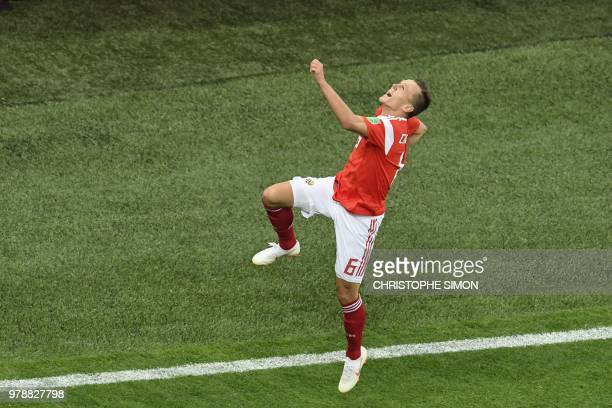 TOPSHOT Russia's midfielder Denis Cheryshev celebrates scoring his team's second goal during the Russia 2018 World Cup Group A football match between...