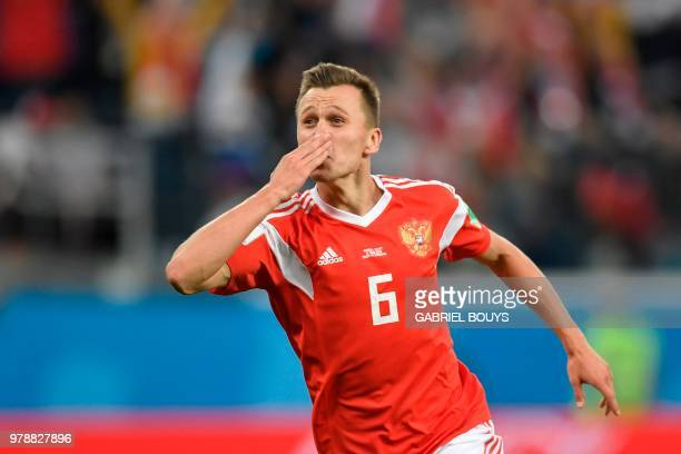 Russia's midfielder Denis Cheryshev celebrates scoring the 20 goal during the Russia 2018 World Cup Group A football match between Russia and Egypt...
