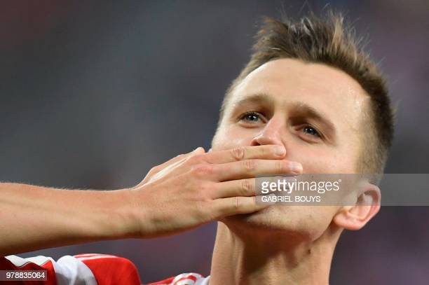 TOPSHOT Russia's midfielder Denis Cheryshev celebrates scoring the 20 goal during the Russia 2018 World Cup Group A football match between Russia and...