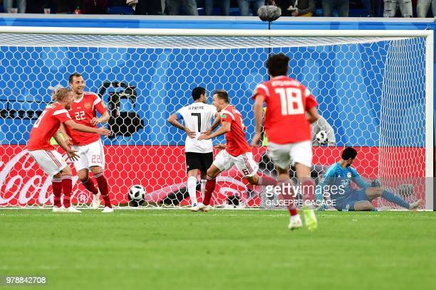 Russia's midfielder Denis Cheryshev scores during the Russia 2018 World Cup Group A football match between Russia and Egypt at the Saint Petersburg...