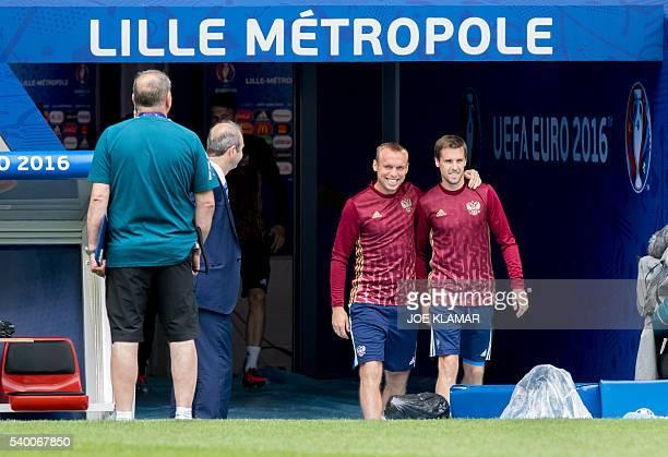 Russia's midfielder Denis Glushakov and defender Dmitri Kombarov arrive for a training session in Villeneuved'Ascq near Lille northern France on June...