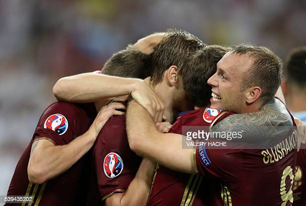 Russia's midfielder Denis Glushakov and teammates celebrate after scoring a goal during the Euro 2016 group B football match between England and...