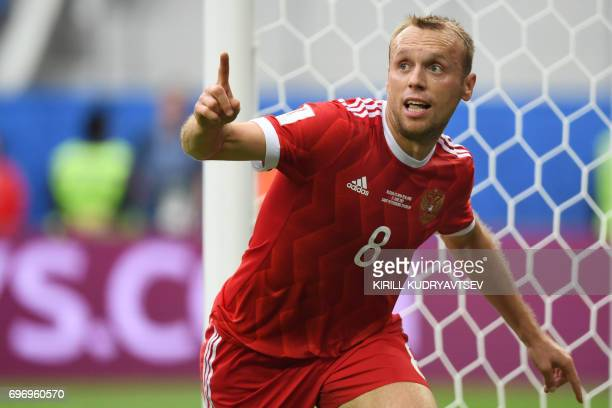 Russia's midfielder Denis Glushakov celebrates after scoring the first goal of the match during the 2017 Confederations Cup group A football match...