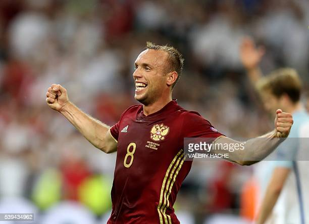 Russia's midfielder Denis Glushakov celebrates his team's goal during the Euro 2016 group B football match between England and Russia at the Stade...