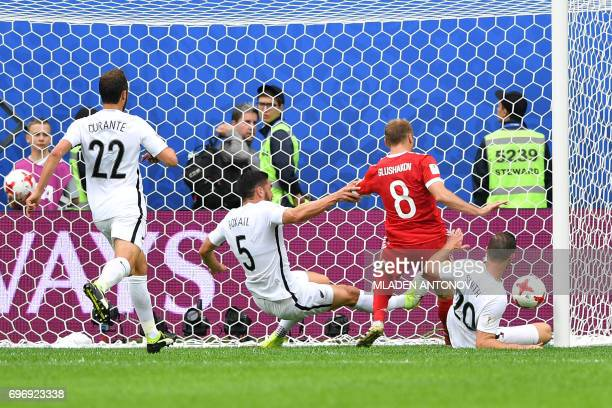 TOPSHOT Russia's midfielder Denis Glushakov score the first goal of the match during the 2017 Confederations Cup group A football match between...