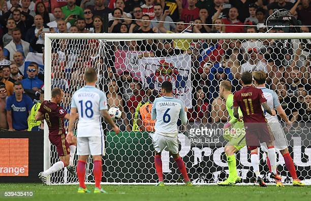 Russia's midfielder Denis Glushakov scores a goal during the Euro 2016 group B football match between England and Russia at the Stade Velodrome in...