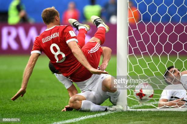 TOPSHOT Russia's midfielder Denis Glushakov scores Russia's first goal during the 2017 Confederations Cup group A football match between Russia and...