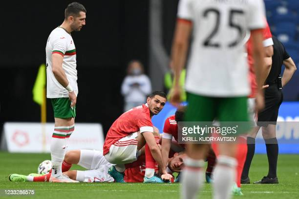 Russia's midfielder Dmitri Barinov lies on the pitch during the friendly football match Russia v Bulgaria in Moscow on June 5 in preparation for the...