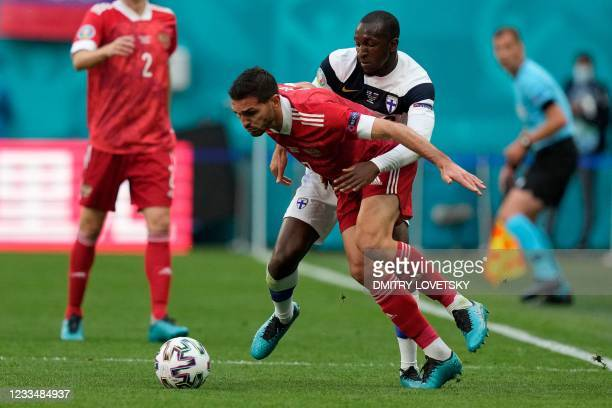 Russia's midfielder Magomed Ozdoev and Finland's midfielder Glen Kamara vie during the UEFA EURO 2020 Group B football match between Finland and...