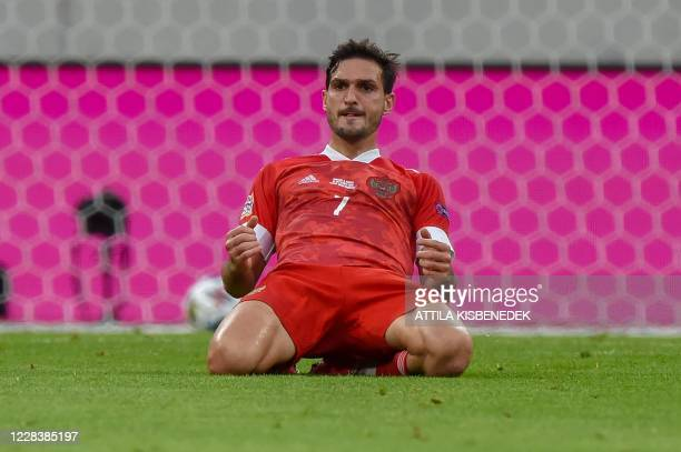 Russia's midfielder Magomed Ozdoev celebrates scoring during the UEFA Nations League football match between Hungary and Russia on September 6, 2020...