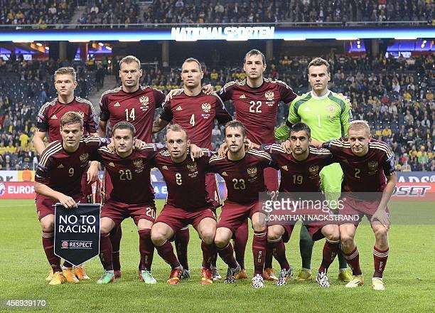 Russia's midfielder Oleg Shatov defender Vasili Berezutski defender Sergei Ignashevich forward Artem Dzyuba and goalkeeper Igor Akinfeev down L to R...