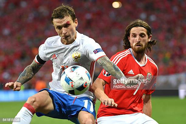 Russia's midfielder Pavel Mamaev vies for the ball against Wales' midfielder Joe Allen during the Euro 2016 group B football match between Russia and...