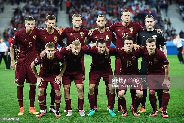Russia's midfielder Roman Neustaedter Russia's forward Fedor Smolov Russia's defender Vasily Berezutskiy Russia's defender Sergey Ignashevich...