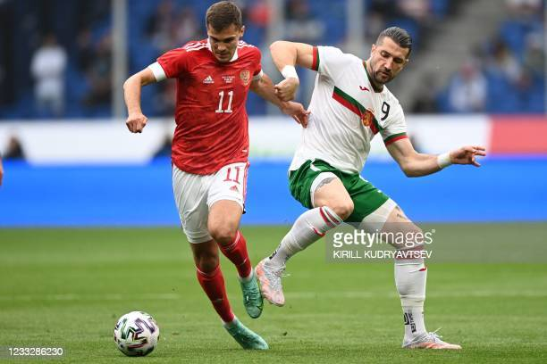Russia's midfielder Roman Zobnin and Bulgaria's striker Andrey Galabinov vie for the ball during the friendly football match Russia v Bulgaria in...
