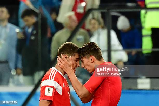 Russia's midfielder Roman Zobnin and Russia's defender Ilja Kutepov celebrate after winning 31 the Russia 2018 World Cup Group A football match...