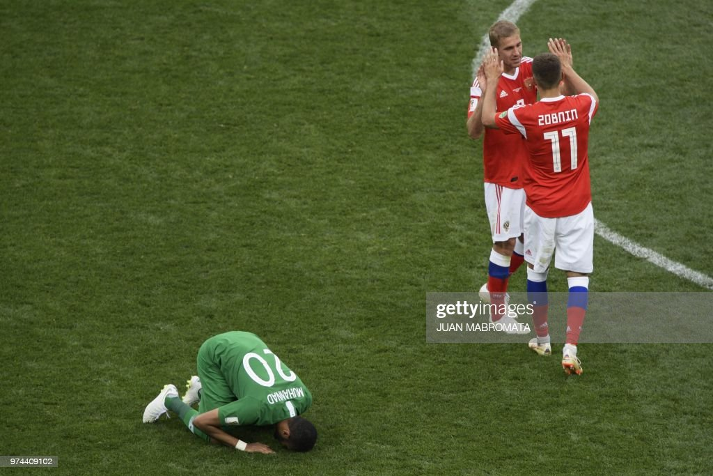 TOPSHOT - Russia's midfielder Roman Zobnin (#11) celebrates with Russia's midfielder Yuri Gazinskiy during the Russia 2018 World Cup Group A football match between Russia and Saudi Arabia at the Luzhniki Stadium in Moscow on June 14, 2018. (Photo by Juan Mabromata / AFP) / RESTRICTED