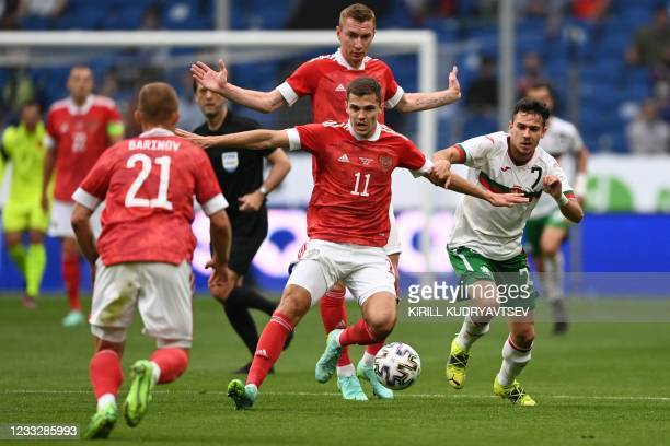 Russia's midfielder Roman Zobnin in action during the friendly football match Russia v Bulgaria in Moscow on June 5 in preparation for the UEFA...