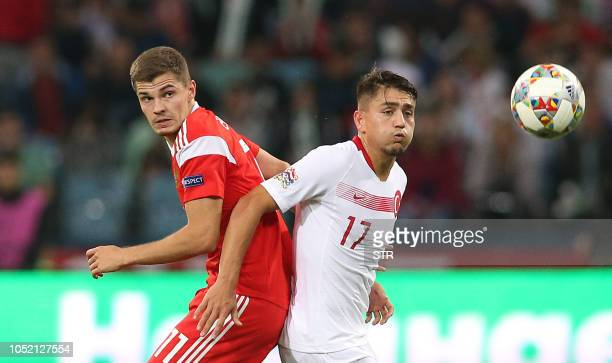 Russia's midfielder Roman Zobnin vies for the ball with Turkey's forward Cengiz Under during the UEFA Nations League football match between Russia...