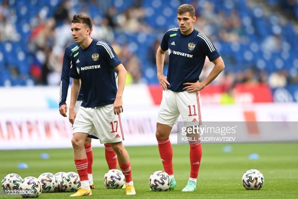 Russia's midfielder Roman Zobnin warms up prior to the friendly football match Russia v Bulgaria in Moscow on June 5 in preparation for the UEFA...