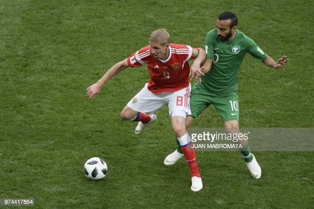Russia's midfielder Yuri Gazinskiy and Saudi Arabia's forward Mohammed AlSahlawi compete for the ball during the Russia 2018 World Cup Group A...