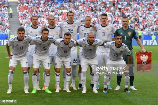 Russia's midfielder Yuri Gazinskiy Russia's defender Sergey Ignashevich Russia's forward Artem Dzyuba Russia's defender Igor Smolnikov Russia's...