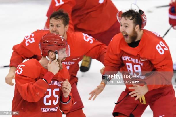 Russia's Mikhail Grigorenko Sergei Shirokov and Nikita Nesterov celebrate winning the men's gold medal ice hockey match between the Olympic Athletes...