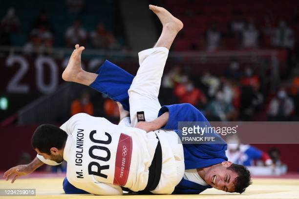 Russia's Mikhail Igolnikov and Georgia's Lasha Bekauri compete in the judo men's -90kg semifinal A bout during the Tokyo 2020 Olympic Games at the...
