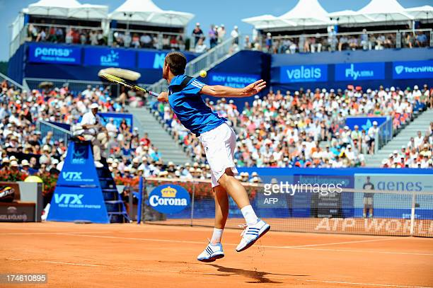 Russia's Mikhail Youzhny returns the ball to Dutch Robin Haase at the Swiss ATP tennis open on July 28 2013 in Gstaad Youzhny won by 6/3 6/4 AFP...