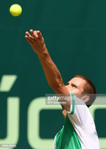Russia's Mikhail Youzhny serves a ball to his compatriot Andrey Rublev during their match of the Gerry Weber Open tennis tournament in Halle western...