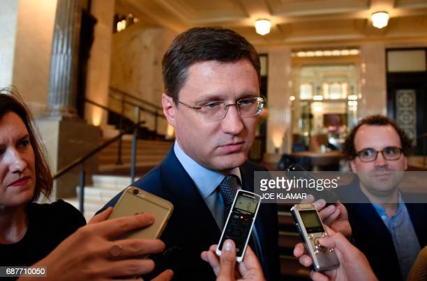 Russia's Minister of Energy Alexander Novak speaks to journalists as he arrives at the hotel in Vienna Austria on May 24 2017 on the eve of the...