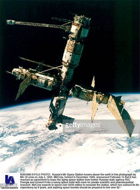 Russia's Mir Space Station hovers above the earth in this photograph by Mir19 crew on July 4 1995 MirCorp formed in December 1999 announced February...