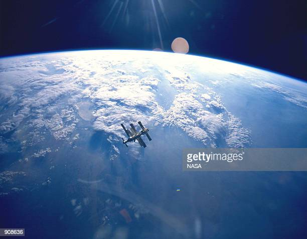 Russia's Mir Space Station is viewed against the backlit earth after separating from the Space Shuttle Atlantis On March 12 it has been reported that...