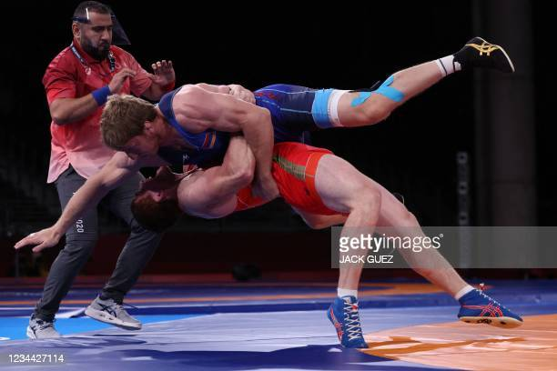 Russia's Musa Evloev wrestles Armenia's Artur Aleksanyan in their men's greco-roman 97kg wrestling final match during the Tokyo 2020 Olympic Games at...