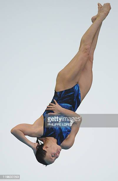 Russia's Nadezda Bazhina competes in the final of the women's 3metre springboard diving event in the FINA World Championships at the outdoor diving...