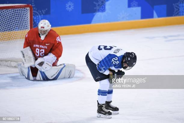 Russia's Nadezda Morozova and Finland's Emma Nuutinen react after colliding in the women's bronze medal ice hockey match between Finland and the...