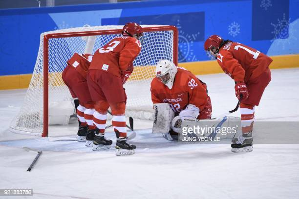 Russia's Nadezda Morozova is looked on by teammates after getting hit by Finland's Emma Nuutinen in the women's bronze medal ice hockey match between...