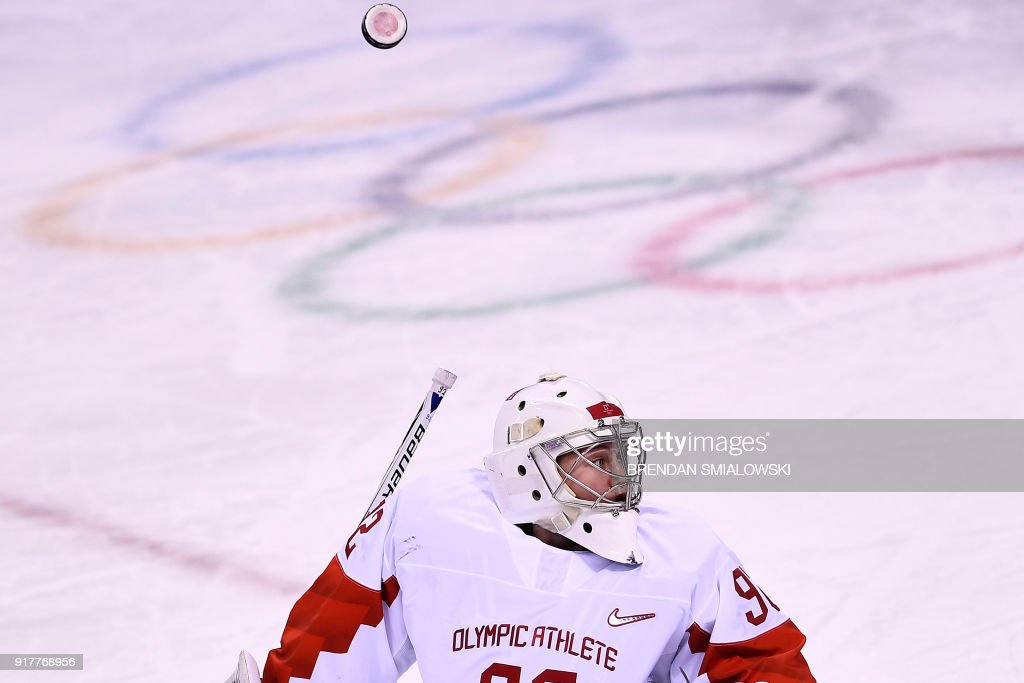 Russia's Nadezda Morozova looks for the puck after blocking a shot in the women's preliminary round ice hockey match between the US and Olympic Athletes from Russia during the Pyeongchang 2018 Winter Olympic Games at the Kwandong Hockey Centre in Gangneung on February 13, 2018. / AFP PHOTO / Brendan Smialowski
