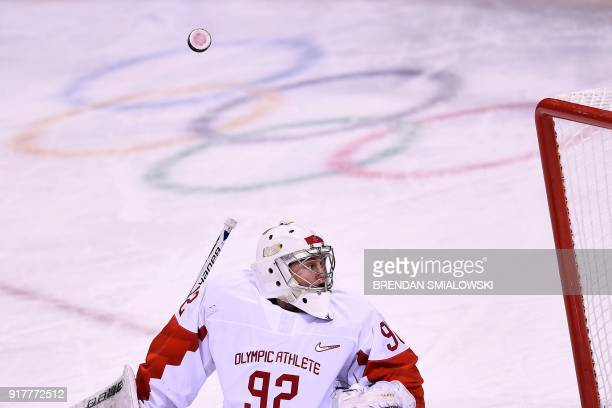 Russia's Nadezda Morozova looks for the puck after blocking a shot in the women's preliminary round ice hockey match between the US and Olympic...