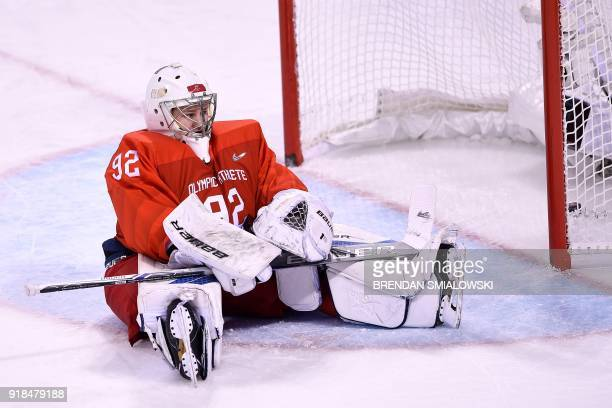 Russia's Nadezda Morozova reacts after letting in a goal in the women's preliminary round ice hockey match between Finland and Olympic Athletes from...