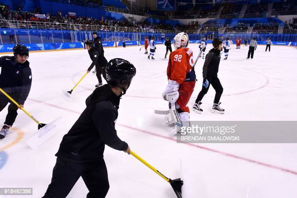 Russia's Nadezda Morozova stands on the ice during a break in the women's preliminary round ice hockey match between Finland and Olympic Athletes...